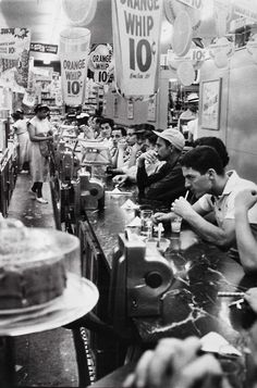 Drugstore soda fountain, Detroit, 1955    Photo by Robert Frank--with jukeboxes, of course.
