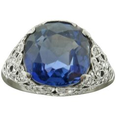 1920s Sapphire Diamond  filigree Platinum Ring   From a unique collection of vintage cocktail rings at https://www.1stdibs.com/jewelry/rings/cocktail-rings/