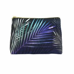 Not your usual make-up bag!  This beautiful navy cosmetics pouch is made from soft eco friendly sustainable linen.   Inspired by tropical islands, botanical illustrations and bold confident style, it has palm leaves in shimmering blues, greens and silvers.  #sustainable #makeupbag #veganmakeup #botanicalstyle