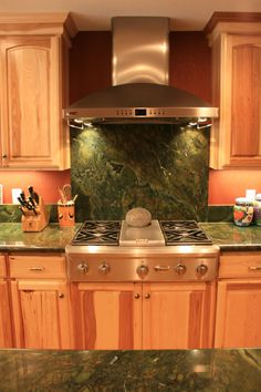 Love this granite. KraftMaid Hickory cabinets