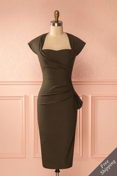 Sondra Khaki -#Boutique1861 / This dress embodies a unique and professional chic and will be perfect for your next cocktail event. The open-back and draped details are undeniably flattering, and the stretchable fabric will kiss your curves in a fitted silhouette.