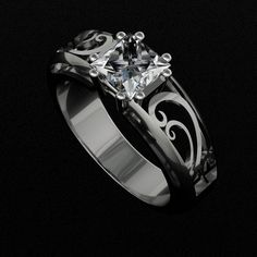 Traditional calm engagement ring with non-traditional setting for princess diamond. www.facebook.com/goldcreationsjeweler
