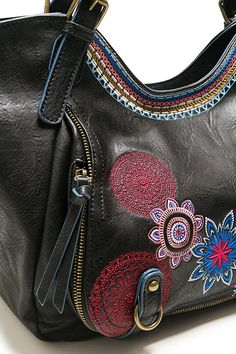 e0d1f6db0c5 Desigual women s black bag with earth tone floral details and a removable  messenger bag strap.