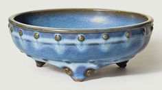 A very rare number three Jun tripod narcissus bowl. Yuan-Ming dynasty, 14th-15th century. 8 ¼ in (21.3 cm) diameter, Japanese wood box. This lot was offered in The Classic Age of Chinese Ceramics The Linyushanren Collection, Part II on 15 September 2016 at Christie's in New York
