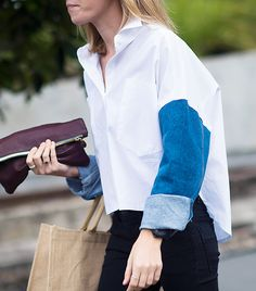 White top with denim sleeves paired with dark jeans