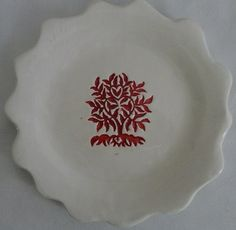 Handmade plate with impression from wooden stamp