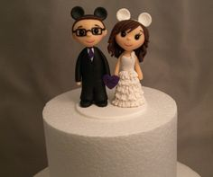 This is adorable because it looks exactly like me and Tim! wedding cake toppers