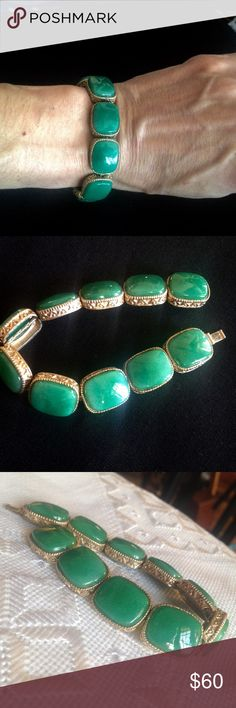 "Vintage Gold & Green Glass Bracelet Mid century, gold toned, green glass, tile link bracelet. Classy, Mad Men design featuring faux jade type glass set in filigree edged bezels. The glass looks like Peking glass, slightly translucent and slightly mottled. Even the link construction is remarkable. Truly a finely crafted, costume piece. Lasting quality because it is still in great condition. Lock mechanism works securely. Beautiful sea green color. Beautiful detailing. 7"" long. A rare find…"