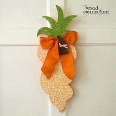 The Wood Connection - Carrot Door Hang, $8.95 (http://thewoodconnection.com/carrot-door-hang/)