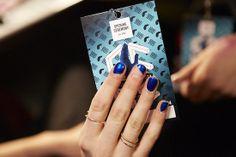 Negative space manicures backstage at Opening Ceremony - Naomi Yasudafor essie#NYFW