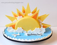 Sunshine Cake - I made this cake for a friend's b-day.  She is soo much like the sun! - radiant, warm, beautiful, full of energy and life!  It was one tier of vanilla cake and butterfinger buttercream cut in half to make a circle.  The board is blue and white fondant swirled and rolled out.  Thanks for looking!