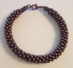 Copper beaded Kumihimo bracelet with copper findings by Jewellery by Janine https://www.facebook.com/JewelleryByJanine