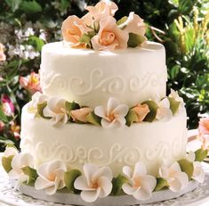 Stacked Round cake w/ Peach Rose Blooms & white flowers