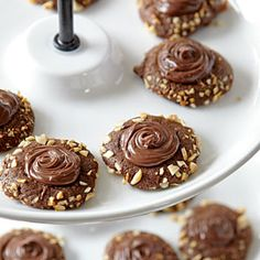 Chocolate-Hazelnut Thumbprints Recipe-With a double shot of chocolate and hazelnut flavors, kids and adults will rave over these filled cookies. The espresso powder is optional, but it intensifies the chocolate flavor.