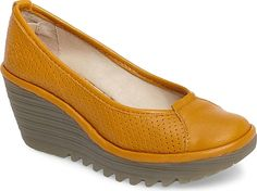9ce205cccfb Fly London Women s Shoes in Honey Leather Color. A signature textured wedge  grounds a simplified
