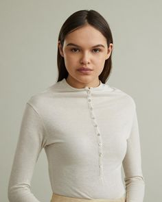 Finely-knit long-sleeve henley shirt with high neckline and long placket. Round neckline Half button placket Long sleeves Viscose Linen Polyamide Model is 175 ft 7 in and is wearing a size XS Long Sleeve Henley, Henley Shirts, Apothecary, Designing Women, Chef Jackets, Neckline, Model, How To Wear, Collection