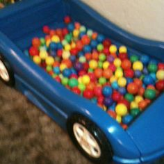 Toddler race car bed used as ball pit!! Well since I can't seem to sell it, maybe??