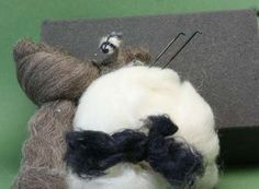 How to Make a Miniature Needle Felted Raccoon Tutorial by Leslie Shepard.