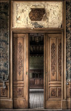 Gorgoeus carved doors in na abandoned mansion. ~ETS