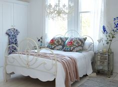 Glam touches mix with cozy old-world pieces--and a perfectly scrumptious knit blanket!--make an inviting retreat.