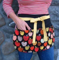 Teachers Utility Apron with Modern Apples in Black with Mustard Ties -- Vendor Apron -- Craft Apron -- Server Apron. $24.75, via Etsy.