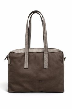 "This bag is handcrafted from soft taupe-colored Napa leather and powdered finish taupe vegetable leather that will age beautifully. Internal zipped and patch pockets ensure that your cell phone, passport, and wallet are always close at hand. The zipper fastening along the top opens up to 43 cm / 16.9 in, so it can easily hold your tablet or laptop. Wear it cross-body, using the adjustable strap, or simply use it as a handbag.     Approx. Measures: 14.9"" W x 11.4"" H x 3.9"" D. 5.9"" handle…"