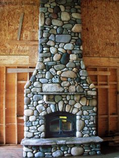 River Rock Fireplace - Interesting mixture of different sized rocks
