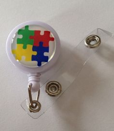 Check out this item in my Etsy shop https://www.etsy.com/listing/184410720/autism-awareness-themed-id-badge-reel