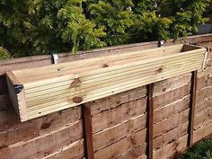 hanging fence planters over the fence panel hanging balcony wooden planter window box decking trough chain link fence hanging planters Hanging Planters Outdoor, Hanging Planter Boxes, Balcony Planters, Trough Planters, Wall Planters, Balcony Garden, Planter Ideas, Plant Troughs, Cheap Planters