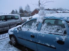 A snowman on top of a car! | Community Post: 40 Creative Snowmen and Other Snow Sculptures :D