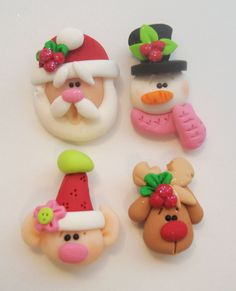Mini Mix Set Santas, Elf, Rudolph, Snowman Polymer Clay Charm Bead Scrapbooking Embelishment Bow Center Pendant Cupcake Topper. $8.50, via Etsy.