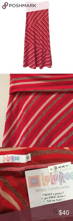 """NWT LuLaRoe maxi skirt NWT LuLaRoe maxi skirt. Size small. The colors are red, tan, and metallic gold. The tag states product may contain any or all of the following materials: rayon, polyester, Lycra, cotton, and nylon. Approximate waist measurement when laid flat is a little over 14"""". The fabric is stretchy. Approximate length is 41"""" and this is measured with the waistband folded over. LuLaRoe Skirts Maxi"""