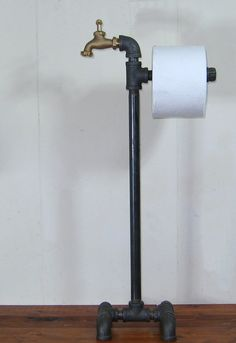 Up for sale is a handmade floor stand toilet paper holder done in the Steampunk or Industrial style. It is 9 wide and 25 tall. This piece is
