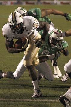 UCF Knights running back Latavius Murray (28) runs in for a second quarter touchdown against Marshall Thundering Herd defensive back Keith Baxter (8) during the second quarter at Joan C. Edwards Stadium.