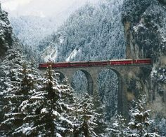 A train of the Rhaetian Railways (RhB) on the Landwasser Viaduct near the village of Filisur (Grisons), Switzerland.
