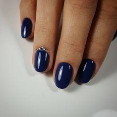 Deep blue and rhinestone nails