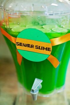 "Teenage Mutant Ninja Turtle First Birthday Party. This ""Sewer Slime"" drink dispenser is so cute."