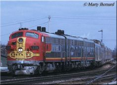 "Santa Fe F7A #339L leads train #23, the westbound ""Texas Chief,"" through Joliet, Illinois during a March evening in 1971."