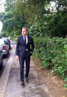 Navy suit, sky blue shirt, brown tie & shoes. #style