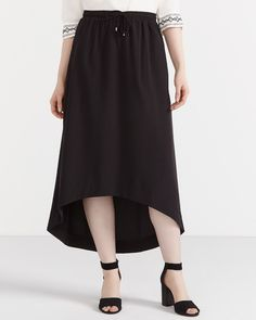 This Maxi Skirt is made of polyester and elastane. It has a drawstring waistband and a flattering and unique high-low hem. Pair this skirt with shirts and blouses for a stylish, feminine outfit.