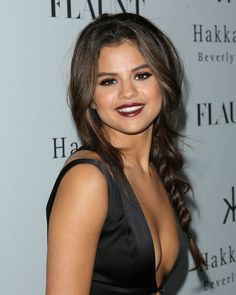 Selena Gomez in a sexy dark lip = side braid