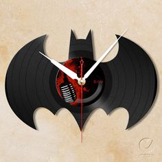 Hey, I found this really awesome Etsy listing at http://www.etsy.com/listing/109175034/vinyl-wall-clock-batman