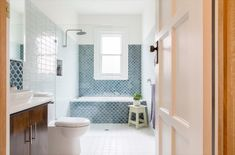 Photo 11 of 25 in Best Bath Porcelain Tile Ceramic Tile Photos from A Cramped Bungalow Is Reborn as an Eco-Minded Abode For Two Gardeners - Dwell Mold In Bathroom, Bathroom Fixtures, White Bathroom, Master Bathroom, Narrow Bathroom, Family Bathroom, Bungalow, Open Showers, Coastal Bathrooms