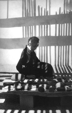 Georgia O'Keeffe sitting with her rock collection, New Mexico, 1966