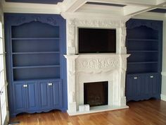 A french fireplace, blue bookcases, coffered ceiling, AND tv. It's perfect, I'll take it!!