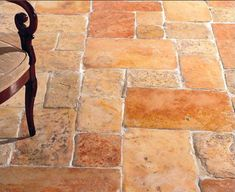 Antique Jerusalem limestone stone floor.  I love this look, but at $35ish psf is hard to justify.