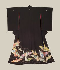 Tomesode (formal kimono). Taisho period (1912-1927), Japan. A silk tomesode featuring 'orizuru' (paper-crane) motifs worked with yuzen resist dyeing, brush-painting and surihaku gold-foil outlining. The Kimono Gallery