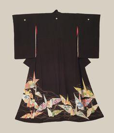 Tomesode (formal kimono).  Taisho period (1912-1927), Japan. A silk tomesode featuring 'orizuru' (paper-crane) motifs worked with yuzen resist dyeing, brush-painting and surihaku gold-foil outlining. The Kimono Gallery
