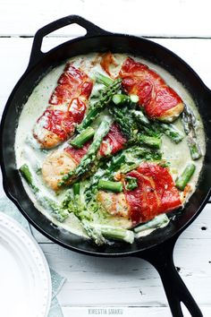 Prosciutto wrapped chicken filet with asparagus and pesto sauce