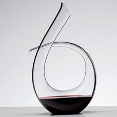 10 Unique Modern Wine Decanters | Keep your bottle of wine looking fine in this beautiful curved glass decanter.